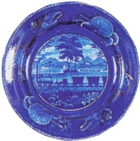 "In 1828 -- before America had its first railroad -- English pottery maker Enoch Wood & Sons was offering a version of its famous ""flow blue"" dinnerware with a railroad theme."