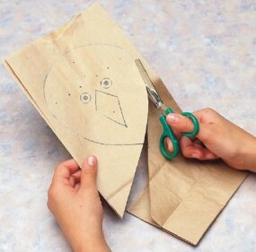 Trace the kite's body onto the paper bag and cut out.