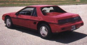 "The Pontiac Fiero GT featured ""flying buttress"" rear roof                              supports and a slick fastback style."