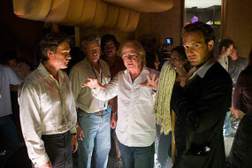 "Kurt Russell, director of photography John Seale, director Wolfgang Petersen and Josh Lucas on the set of ""Poseidon."""