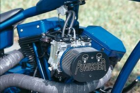 Punisher's air cleaner cover with a prominent Wrench Custom Cycles logo and chopper name.