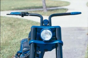 The Wrench Custom Cycles displays a blue skull from it logo above Punisher's handlebars.