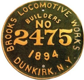 "On the flanks of almost every steam locomotive, a plaque provided the engine's pedigree. This was its ""birth certificate."" This plaque was from the 2,475th locomotive built by the Brooks Locomotive Works."