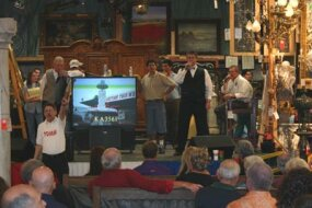 TV monitors are used to give bidders an up-close glimpse of items outdoors and on the auction floor.