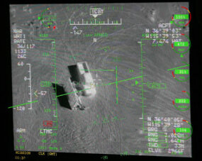 During a training mission at Creech Air Force Base, a pilot's display at the ground control station shows a truck from the view of a camera on an MQ-9 Reaper.