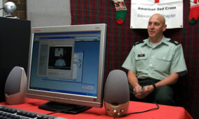 Sgt. Maj. Ronald Simons talks to his son through the Red Cross' Project Video Connect.
