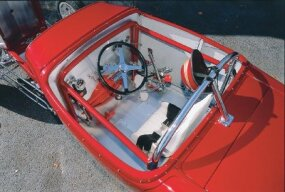 The Roubal Drag Roadster is painted candy-apple red and sports a billiard ball shift knob.