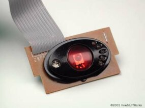 "The robot's ""laser unit"": An infrared LED to shoot light beams and a photocell to receive them"