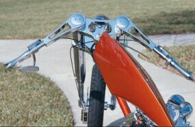 The custom-built machined billet handlebars on this chopper further illustrate the bike's streamlined appearance.