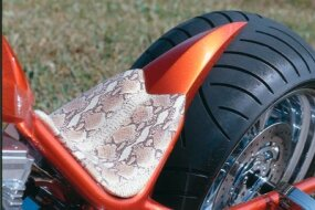 The Sabre Tooth's exotic snakeskin seat, a typical feature of Precious Metal Customs choppers.