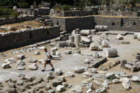 A tourist walks through the ruins of the Mausoleum of Halicarnassus in Bodrum, Turkey.