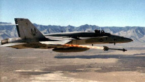 A Sidewinder launches from an F/A-18 Hornet.