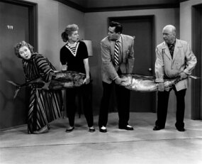 "­Vivian Vance, Lucille Ball, Desi Arnaz and William Frawley hold a tuna fishing contest on an episode of ""I Love Lucy"" from 1956."