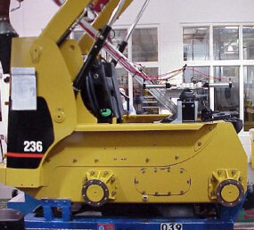 A robotic operator exercises the hydraulics during a thermal cycle test.
