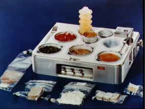 ­The Skylab program of the 1970s used trays like this to keep food in place.