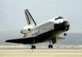 Space shuttle orbiter touching down