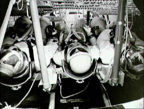 There wasn't much elbow room in the Apollo command module during takeoff and landing.