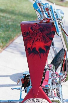 Subtle but elaborate artwork gracing its top is more visible to the rider than to onlookers.