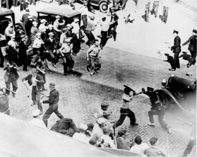 Strikers battle police with clubs and pipes during the 1934 Minneapolis General Drivers and Helpers Union strike.