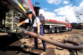 trucker fueling truck