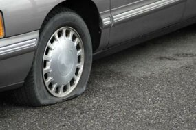 A flat pneumatic tire