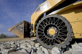 Construction vehicle using the Tweel Airless Tire.