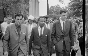 James Meredith, walking to class at the University of Mississippi, is escorted by U.S. Marshals.