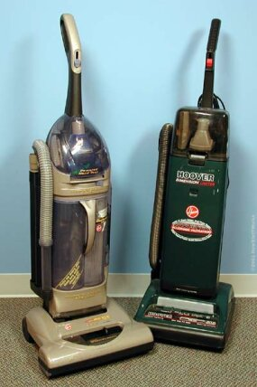 "Two upright vacuum cleaner models, one with the conventional bag system (right), and the other with the new ""cyclone"" system (left)."