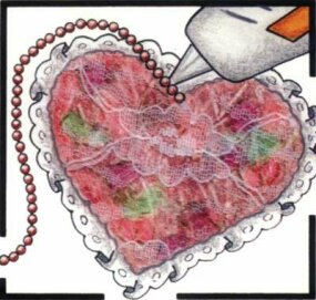 Glue the pearls to the lace side of the heart.