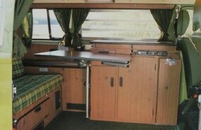 The 1979 Campmobile listed for nearly $8,000, but featured sleeping space for four, plus a stove, refrigerator, table, closets, and louvered side windows.