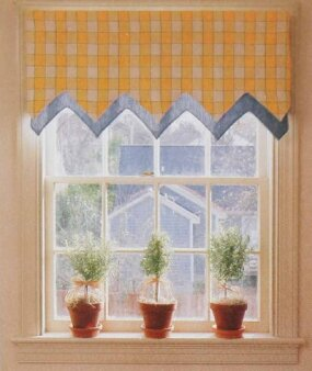 ©This End Up Furniture Co., Inc. Topped with only a pennant valance in sunny yellow and white checks with blue trim, this kitchen window is left bare except for three herb topiaries gracing its sill.