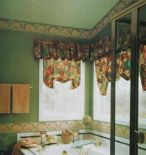 The fabrics featured in this window treatment are presented in two different tones -- one lighter and one darker.