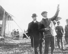 Wilbur Wright uses an anemometer to check wind speed before a flight.