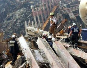 Rescue workers search through the rubble, two weeks after the attack.