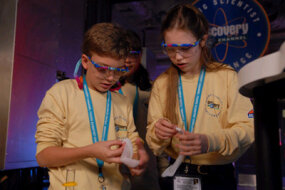 "The yellow team's Christopher Mowers and Bethany Johnson work on ""The Hot and Cold Of It"" chemistry challenge at the Discovery Education and 3M Young Scientist Challenge."