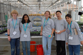 "Team Grey members Matthew Mooney, Shubha Raghvendra, Morgan Monroe, Benjamin Song and Kyrillos Tawadros pose with a DCYSC ice sculpture after completing the ""Water, Water Everywhere"" challenge at the University of Maryland's Greenhouse Facility at the 2007 Discovery Education and 3M Young Scientist Challenge."