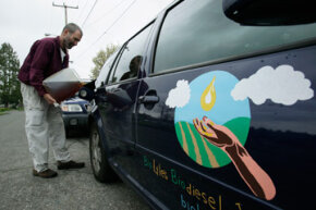 Lyle Rudensey fills up his car with homemade biodiesel that he refined from used cooking oil in his garage, on April 22, 2009, in Seattle, Wash.