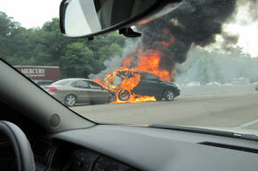 The threat of a fire might not be immediately apparent; however, it's always best to move away from a damaged car as soon as possible.