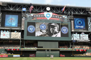 The scoreboard at Chase Field dwarfs players and fans alike. This photo was taken on April 15, 2009, in a game against the St. Louis Cardinals.