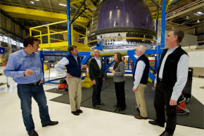 NASA visits with Blue Origin founder Jeff Bezos, third from left, in December 2011. You can see Blue Origin's crew capsule in the background.