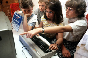 The Commodore 64 never caught on in Europe or Asia the way it did in the U.S., but it still reached plenty of users. Here, German children try out a model in 1985.