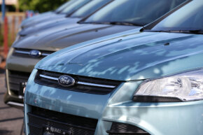 Brand new Ford Escape SUVs are displayed on the sales lot at Journey Ford on June 4, 2013, in Novato, California.