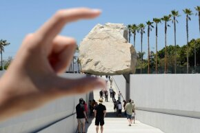 Click ahead to learn more about how this huge boulder was moved.