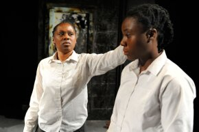 """Actresses Natasha Gordon and Demi Oyediran as the Gibbons twins in a play exploring their unusual story titled """"Speechless"""" at the Edinburgh Festival Fringe in 2010."""
