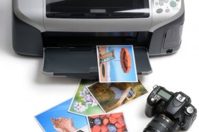 The money you spend printing your vacation photos at home could be funneled into your fund for your next trip instead.