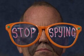 A protester with the group Code Pink demonstrates against the U.S. National Security Agency's practice of secretly collecting people's phone records and Internet activity data. See spy pictures.