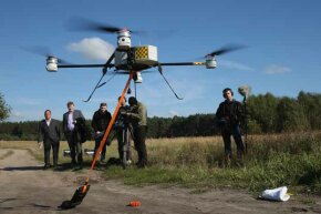 Journalists watch a quadrocopter drone with a device for marking telephone cables with artificial DNA take off in 2013. Deutsche Telekom is releasing drones across Germany to fight cable theft, which has shot up with the increasing value of copper.