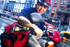 The good times: Joseph Park, Kozmo.com CEO, making a delivery via moped in New York City in late 1999.
