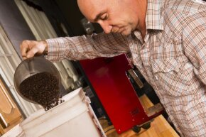 Witnessing coffee beans turn from green to a nice roasted brown is much more involved — and takes longer — than most people think.