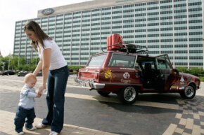 Image Gallery: Parenting Cecilia Percivaldi with her son Agustin, next the family's 1981 Ford Falcon at Ford Motor Co.'s headquarters in Dearborn, Mich. The Percivaldi family drove almost 10,000 miles through 11 countries, from Argentina to Dearborn. The trip took 47 days. See more parenting pictures.